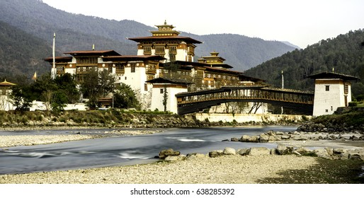Punakha Dzong on a clear sunny day with a long exposure river.