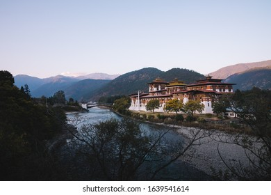 The Punakha Dzong in twilight time with tree border. Punakha Dzong was the administrative centre and the seat of the Government of Bhutan until 1955, when the capital was moved to Thimphu.