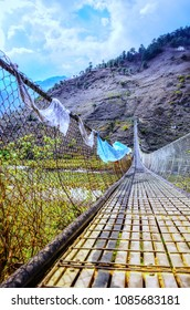 Punakha Suspension Bridge cross the Pho Chhu river and prayer flags hanging on Rail Bridge
