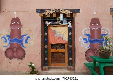 Punakha,Bhutan-April 2, 2015:Phallic image paintings on the house near Chimi Lhakhang monastery.The phallus depicts knowledge. It is not a sexual gimmick when displayed on the wall of the house.