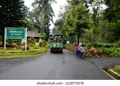 Puncak, West Java / Indonesia - October 03 2018: Views at tea factory in Puncak West Java showing tea plantation, old factory buildings and local tourists walking around the area.