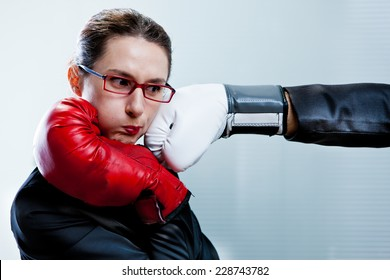 a punch in the face of a business woman