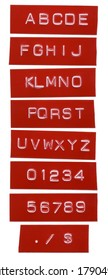 punch letter alphabet on red labeling tape