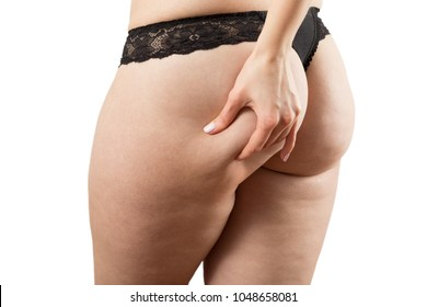punch oversized female buttocks with cellulite on white background isolated