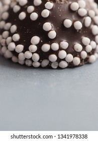 Punch praline sweets close up on grey background