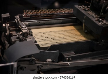 The punched card of an old device.