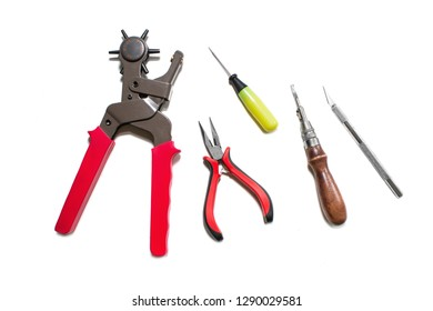 Puncher, awl, pliers, scalpel, notch isolated on white background. View from above