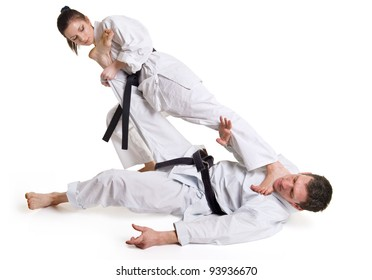 punch.figure in the karate fighting stance on a white background.hand-to-hand fighting.man and woman.