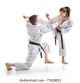 punch.figure in the karate.Training fight.two fighters on a white background hand-to-hand fighting.man and woman.