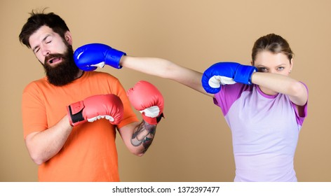 punching, sport Success. sportswear. Fight. training with coach. knockout and energy. couple training punching in boxing gloves. Happy woman punching bearded man workout in gym. girl punching