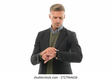 Punctuality is in the business world. Handsome man check watch. Businessman with wrist watch on hand. Mans watch. Portable timepiece. Fashion accessory. Formal style. Putting watch right.