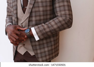 Punctuality concept.  businessman checking time on his wristwatch. men's hand with a watch, watch on a man's hand, the fees of the groom, wedding preparation, preparation for work, man's style