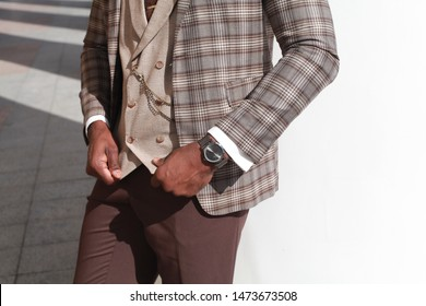 Punctuality concept.  businessman checking time on his wristwatch. men's hand with a watch.