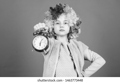 Punctuality is a kingly virtue. Cute little child demanding punctuality. Adorable small girl strictly observing punctuality. Punctuality concept.