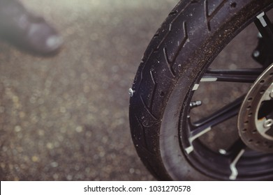 punctured motorcycle wheel, a nail sticks out of the tire, tire fitting.
