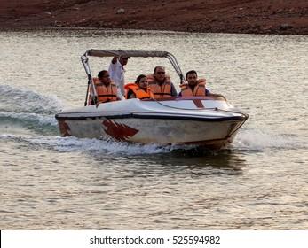 Pune / India - April 13, 2013 - family / group enjoying the motor / speed boat ride in Panshet lake water