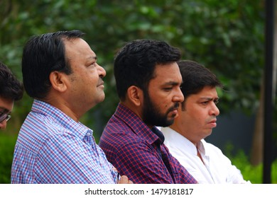 Pune, India - August 15 2019: Candid portrait of three men outdoors at Pune India.