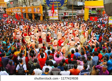 PUNE, INDIA, August 2017, Dhol tasha pathak with crowd celebrating Ganapati festival