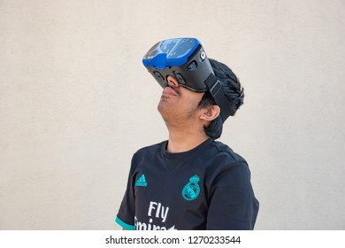 Pune, India - December 30 2018: Indian teenager using a VR headset at Pune India.