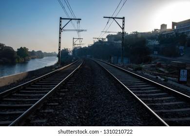 Pune, India - February 10 2019: Railway tracks with electrification at Kamshet near Pune India.