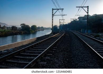Pune, India - February 10 2019: Railway tracks with electrification at Kamshet station near Pune India.