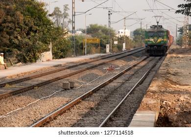 Pune, India - January 05 2019: Honking locomotive heading a freight train of the Indian Railway at Manjari Budruk station near Pune India.
