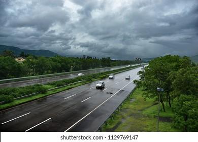 Pune, India - July 08 2018: The Mumbai Pune Expressway during the monsoon season near Lonavala India.