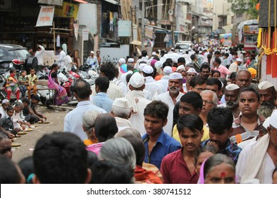 Pune, India - July 11, 2015: Thousands of people throng to a pilgrimmage in India during the Wari festival