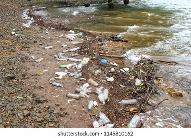 Pune, India - July 29 2018: Pollution by the lake at Mulshi near Pune India.