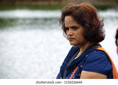 Pune, India - July 29 2018: Candid portrait of a middle aged lady outdoors at Tamhini near Pune India.
