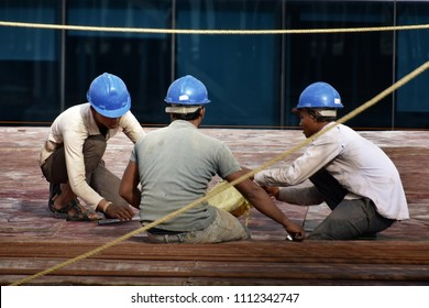Pune, India - June 13 2018: Construction workers at a construction site at Pune India.