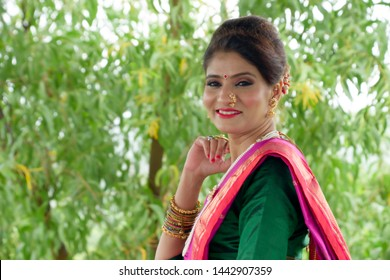 Pune, India - June 30 2019: An Indian lady in a traditional Maharashtrian saree posing outdoors at Pune India.