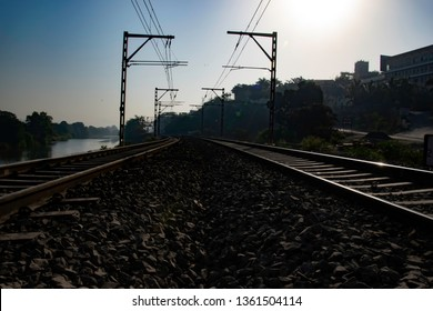 Pune, India - March 24 2019: Railway tracks with electrification at Kamshet station near Pune India.