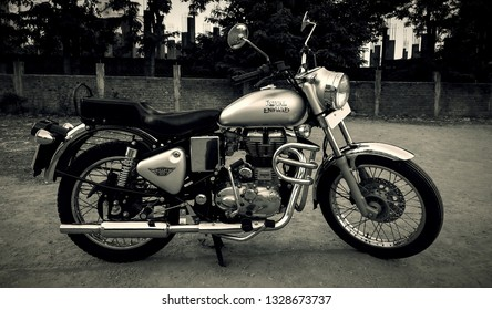 Pune / India - May 01, 2017 - Classical Royal Enfield Bullet Electra 350 bike parked on the rough road with a retro vintage old style filter effect