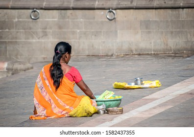 Pune, India - May 05 2019: A lady flower seller at Alandi Temple near Pune India.