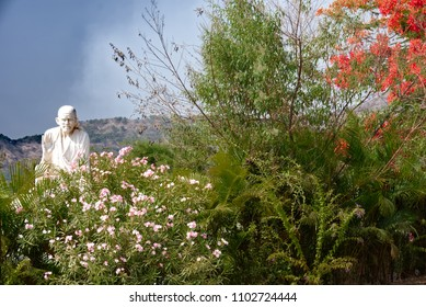 Pune, India - May 26 2018: Saibaba statue amidst natural surroundings at Hadshi Temple near Pune India.