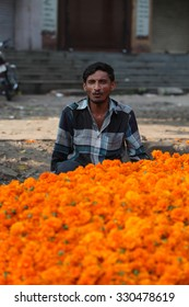 Pune, India - October 21, 2015: A flower seller with his marigold flowers  in India, on the eve of Dassera festival