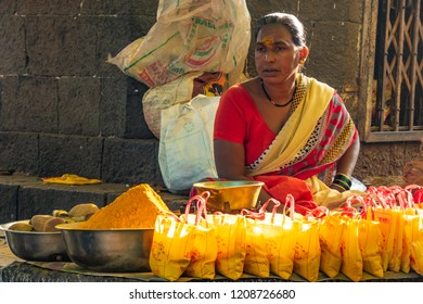 Pune, India - October 21 2018: Lady selling Turmeric power at Khandoba Temple at Jejuri near Pune India. Turmeric powder is part of Hindu rituals at this temple.