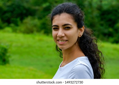 Pune, India - September 01 2019: Portrait of a young Indian girl outdoors near Pune India.