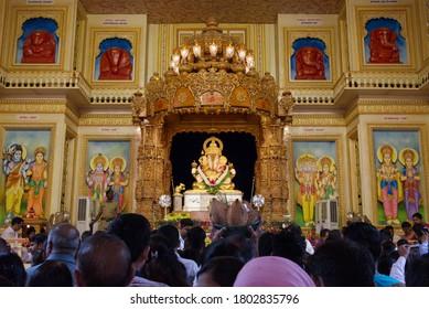 Pune, India - September 19, 2018 - Devotees chanting praying at Dagdusheth Halwai Ganpati Mandir during Hindu god Ganesh Chaturathi festival before immersing in the ocean