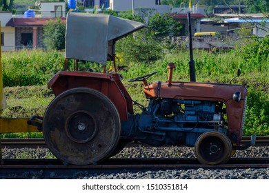 Pune, India - September 21 2019: A tractor with trolley modified for the railways at a Railway construction site near Pune India.
