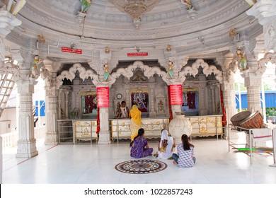 Pune, Maharashtra, India, 2017 People praying inside temple. Ashapura Mataji temple, Katraj road
