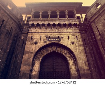 Pune, Maharashtra, India, 26 December 2018. The entrance of the shaniwar wada fort of the Peshwas of Maratha empire in Pune. The board on the entrance says 'Shaniwar Wada' meaning the 'Saturday fort'.