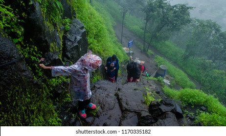PUNE, MAHARASHTRA, INDIA- AUGUST 2018: Five year old kid on a trek to Tikona fort during the monsoon season.