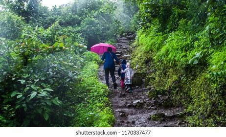 PUNE, MAHARASHTRA, INDIA- AUGUST 2018: Trek to Tikona fort during the monsoon season. Tikona fort is a popular trek near Lonavala. It is suitable for beginners.