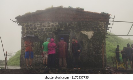 PUNE, MAHARASHTRA, INDIA- AUGUST 2018: View of the top of Tikona fort during the monsoon season. Tikona fort is a popular trek near Lonavala. It is suitable for beginners.
