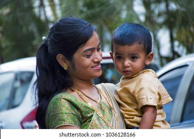 PUNE, MAHARASHTRA, INDIA, February 2017, Mother smiles at her child