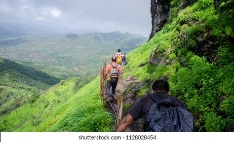 PUNE, MAHARASHTRA, INDIA- JULY 2018: Rajgad fort trek during the monsoons in the Sahyadris. Monsoon treks are very popular in the Western Ghats.