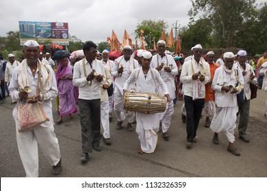 PUNE, MAHARASHTRA, INDIA, June 2016, Pilgrims or warkari performing bhajan or holy song at Pandarpur yatra