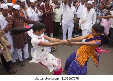 PUNE, MAHARASHTRA, INDIA, June 2016, Pilgrims performing fugadi, a rural dance form Pandharpur Yatra